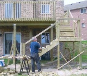 Decks fences samson 39 s carpentry for Deck ideas above walkout basement